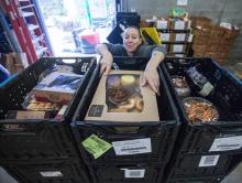 Woman sorting food donations at Hopelink